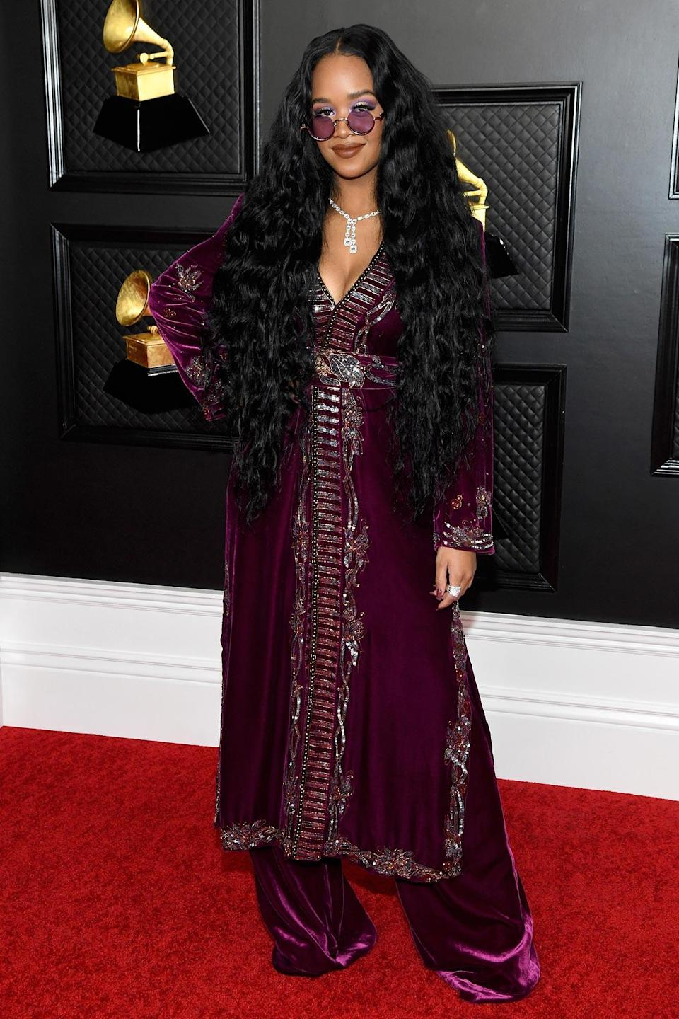 """<p>Though the <a href=""""https://ew.com/awards/grammys/"""" rel=""""nofollow noopener"""" target=""""_blank"""" data-ylk=""""slk:63rd annual Grammy Awards"""" class=""""link rapid-noclick-resp"""">63rd annual Grammy Awards</a> look a little different this year, thankfully there is still a red carpet! Keep clicking to see all the stars who posed for the cameras (socially distanced, of course) at the Los Angeles Convention Center on Sunday.</p>"""