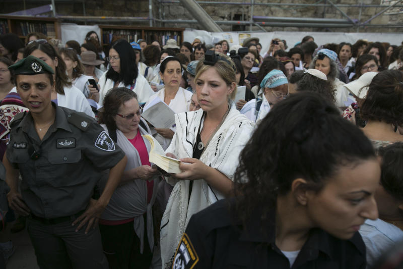 "An Israeli Jewish woman of the Women of the Wall organization prays while wearing a prayer shawl at the Western Wall, the holiest site where Jews can pray in Jerusalem's old city, Sunday, June 9, 2013. The group, known as ""Women of the Wall,"" convenes monthly prayer services at the Western Wall, wearing prayer shawls and performing rituals that ultra-Orthodox Jews believe only men are allowed to do. (AP Photo/Michal Fattal) ISRAEL OUT"