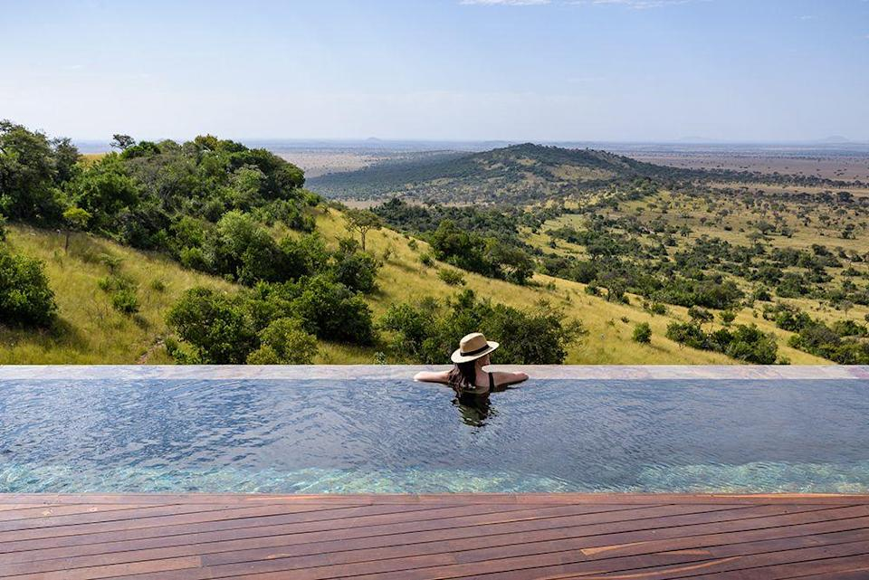 """<p>You can gaze out over the Serengeti plains from this <a href=""""https://singita.com/lodge/singita-sasakwa-lodge/"""" rel=""""nofollow noopener"""" target=""""_blank"""" data-ylk=""""slk:infinity pool"""" class=""""link rapid-noclick-resp"""">infinity pool</a>, the perfect place to cool down after an early morning game drive spotting the big five.</p>"""