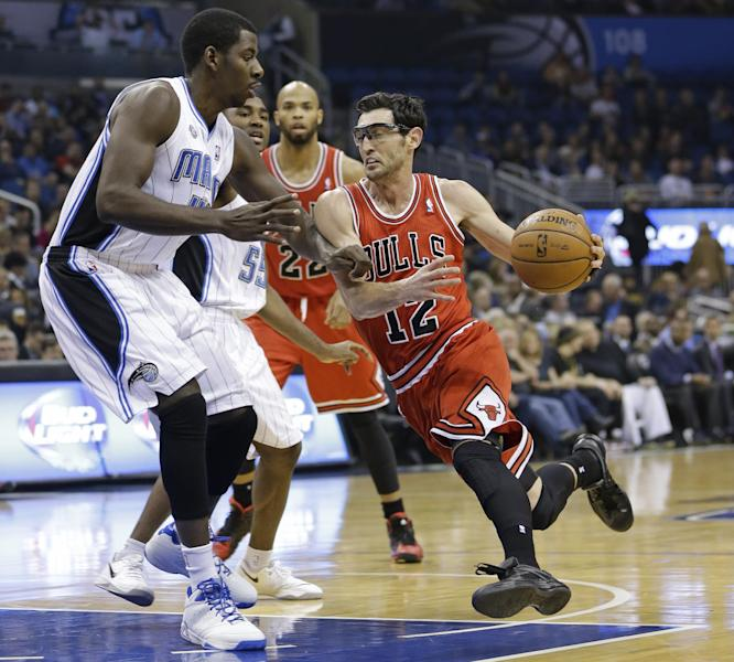 Chicago Bulls' Kirk Hinrich (12) drives around Orlando Magic's Andrew Nicholson, left, for a basket during the first half of an NBA basketball game in Orlando, Fla., Wednesday, Jan. 15, 2014. (AP Photo/John Raoux)