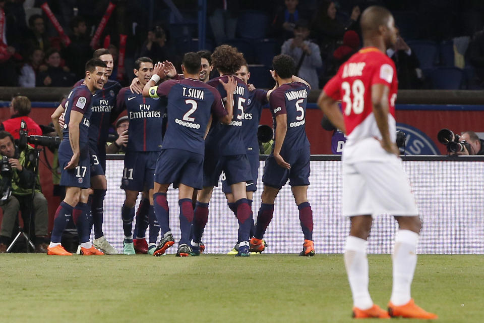 PSG players celebrate one of many goals in a title-clinching win over Monaco. (AP)