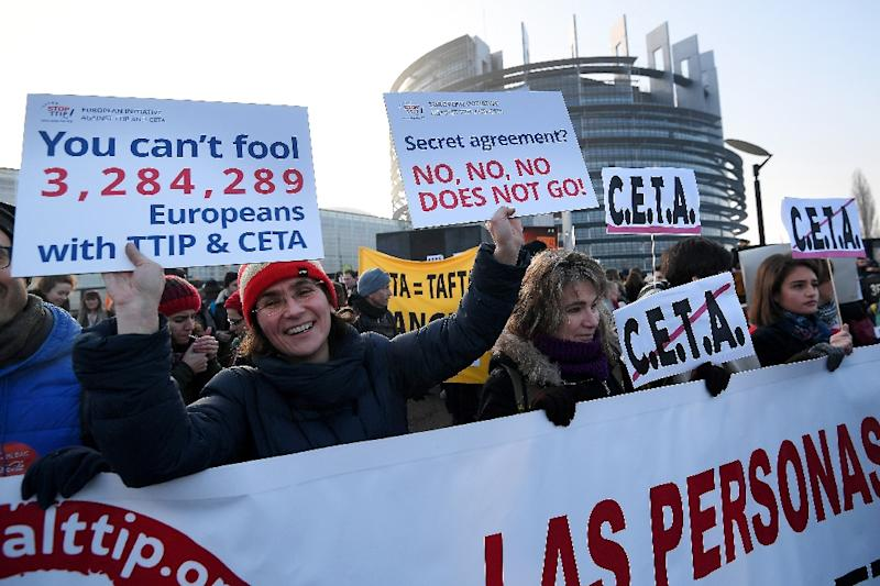 Protestors demonstrate against the EU-Canada trade deal outside the European Parliament in Strasbourg, France (AFP Photo/FREDERICK FLORIN)