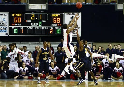 Belmont guard Kerron Johnson (3) shoot the game- winning shot over Murray State guard Jordan Burge (33) during overtime of an NCAA college basketball game in the Ohio Valley Conference tournament championship on Saturday, March 9, 2013, in Nashville, Tenn. Belmont won in overtime 70-68. (AP Photo/Wade Payne)
