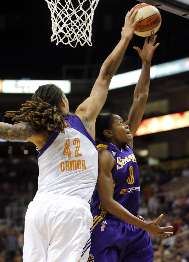 Phoenix Mercury's Brittney Griner (42) blocks the shot of Los Angeles Sparks' Alana Beard during the first half of Game 2 of a WNBA basketball Western Conference semifinal series, Saturday, Sept. 21, 2013, in Phoenix. (AP Photo/Matt York)