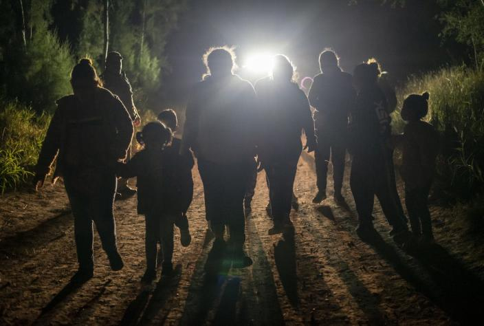 "<span class=""caption"">If a proposed law passes, this group of immigrants apprehended at the U.S. border near Mission, Texas, would be called 'noncitizens,' not 'aliens.'</span> <span class=""attribution""><a class=""link rapid-noclick-resp"" href=""https://www.gettyimages.com/detail/news-photo/group-of-undocumented-immigrants-walk-toward-a-customs-and-news-photo/1231297089?adppopup=true"" rel=""nofollow noopener"" target=""_blank"" data-ylk=""slk:Sergio Flores for The Washington Post via Getty Images"">Sergio Flores for The Washington Post via Getty Images</a></span>"