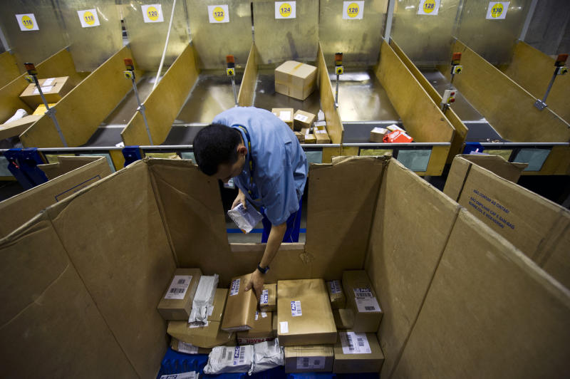 An employee works in the sorting office of the Brazilian post office on September 11, 2013, in Sao Paulo, Brazil. AFP PHOTO / Nelson ALMEIDA (Photo credit should read NELSON ALMEIDA/AFP via Getty Images)