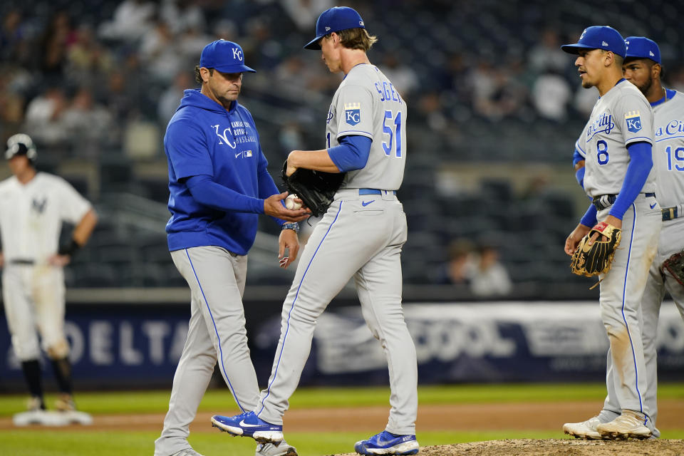 Kansas City Royals manager Mike Matheny takes the ball from Royals starting pitcher Brady Singer (51) with bases loaded in the fourth inning of a baseball game against the New York Yankees, Tuesday, June 22, 2021, at Yankee Stadium in New York. (AP Photo/Kathy Willens)