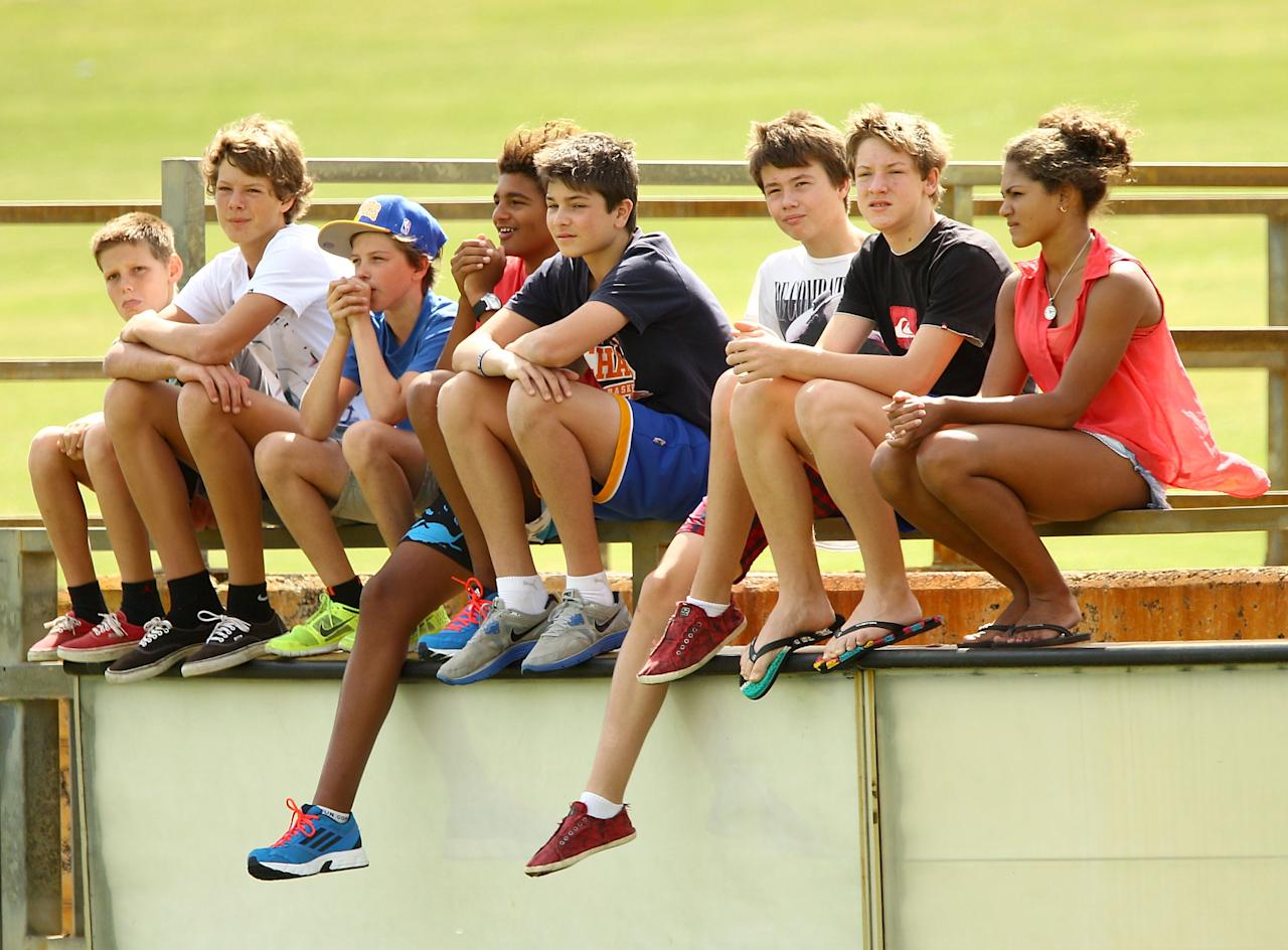PERTH, AUSTRALIA - OCTOBER 02: Youths watch the action while sitting on the fence during day three of the Sheffield Shield match between the Western Australia Warriors and the Victorian Bushrangers  at the WACA on October 2, 2012 in Perth, Australia.  (Photo by Paul Kane/Getty Images)