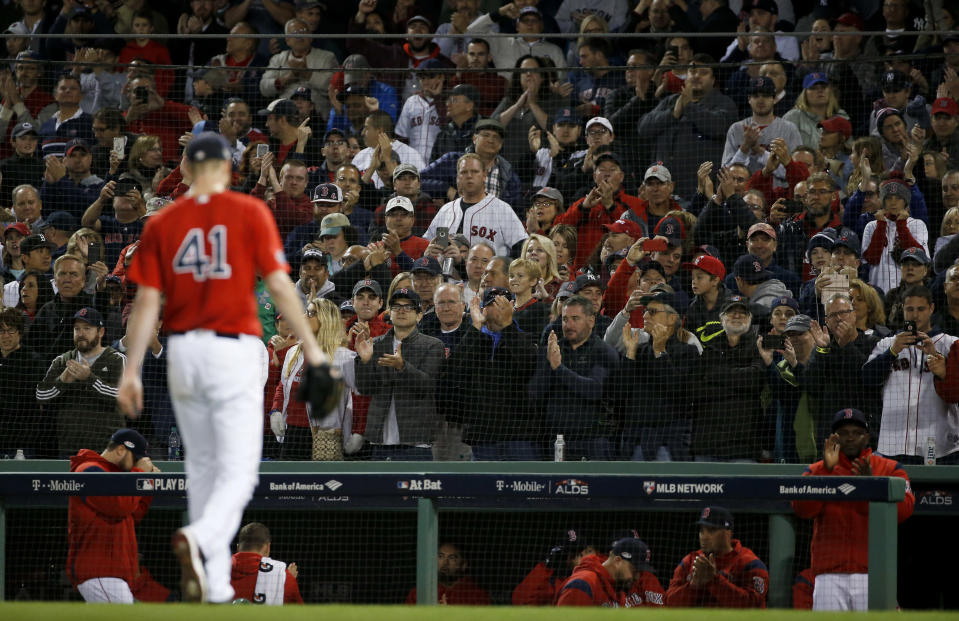 Fans cheers as Boston Red Sox starting pitcher Chris Sale leaves the baseball game against the New York Yankees during the sixth inning of Game 1 of an American League Division Series on Friday, Oct. 5, 2018, in Boston. (AP Photo/Elise Amendola)
