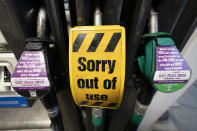 An out of use sign is seen on a pump at a petrol station after the current outbreak of fuel panic buying in the UK, in Manchester, England Monday, Sept. 27, 2021. British Prime Minister Boris Johnson is said to be considering whether to call in the army to deliver fuel to petrol stations as pumps ran dry after days of panic buying. ( AP Photo/Jon Super)