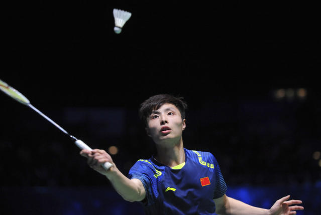 China's Shi Yuqi returns a shot to China's Lin Dan during the men's singles final match at the All England Open Badminton tournament in Birmingham, England, Sunday March 18, 2018. (AP Photo/Rui Vieira)