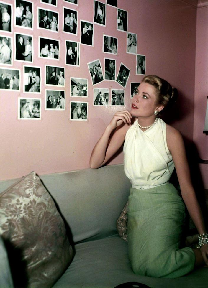 <p>Kelly added a touch of personalization to her dressing room in 1955, plastering black and white photographs on the wall. </p>