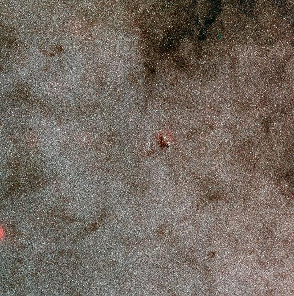 This wide-field view shows the very rich star fields of the Large Sagittarius Star Cloud and the cluster NGC 6520 and the neighbouring dark cloud Barnard 86. It was created from images from the Digitized Sky Survey 2.