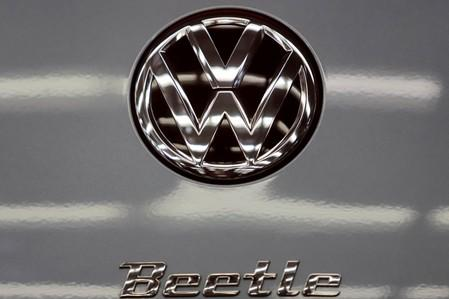 FILE PHOTO: A logo is seen on a Volkswagen Beetle car during a ceremony marking the end of production of VW Beetle cars, at company's assembly plant in Puebla