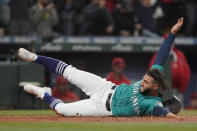 Seattle Mariners' Abraham Toro scores during the second inning of a baseball game against the Los Angeles Angels on a double hit by Mariners' Jarred Kelenic, Friday, Oct. 1, 2021, in Seattle. (AP Photo/Ted S. Warren)