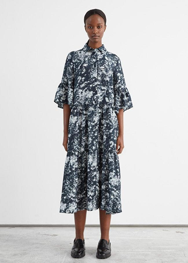 """<h3><strong><h2>& Other Stories Buttoned A-Line Midi Dress</h2></strong></h3><br><strong>Why It's A Best Buy</strong>: No longer a throwback vintage-store buy, the accommodatingly chic housedress is an indisputable style necessity — especially as the weather begins to warm up and we emerge bleary-eyed from winter hibernation. While we're saving the skimpier iterations of this style for the sweltering heights of August, we're on the hunt right this second for more layerable takes on this frock — perfect for transitioning out of the cold.<br><br><strong>The Review</strong>: In her story about <a href=""""https://www.refinery29.com/en-us/comfortable-clothing-covid-fashion-trend"""" rel=""""nofollow noopener"""" target=""""_blank"""" data-ylk=""""slk:the pandemic's biggest trends"""" class=""""link rapid-noclick-resp"""">the pandemic's biggest trends</a>, writer Cait Munro quoted behavior psychologist Dr. Carolyn Mair: """"We tend to feel more 'dressed up' when wearing a dress than other garments, and so choosing a comfortable style of dress during the pandemic makes perfect sense.""""<br><br><strong>& Other Stories</strong> Buttoned A-Line Midi Dress, $, available at <a href=""""https://go.skimresources.com/?id=30283X879131&url=https%3A%2F%2Fwww.stories.com%2Fen_usd%2Fclothing%2Fdresses%2Fmini-dresses%2Fproduct.buttoned-a-line-midi-dress-black.0948828001.html"""" rel=""""nofollow noopener"""" target=""""_blank"""" data-ylk=""""slk:& Other Stories"""" class=""""link rapid-noclick-resp"""">& Other Stories</a>"""