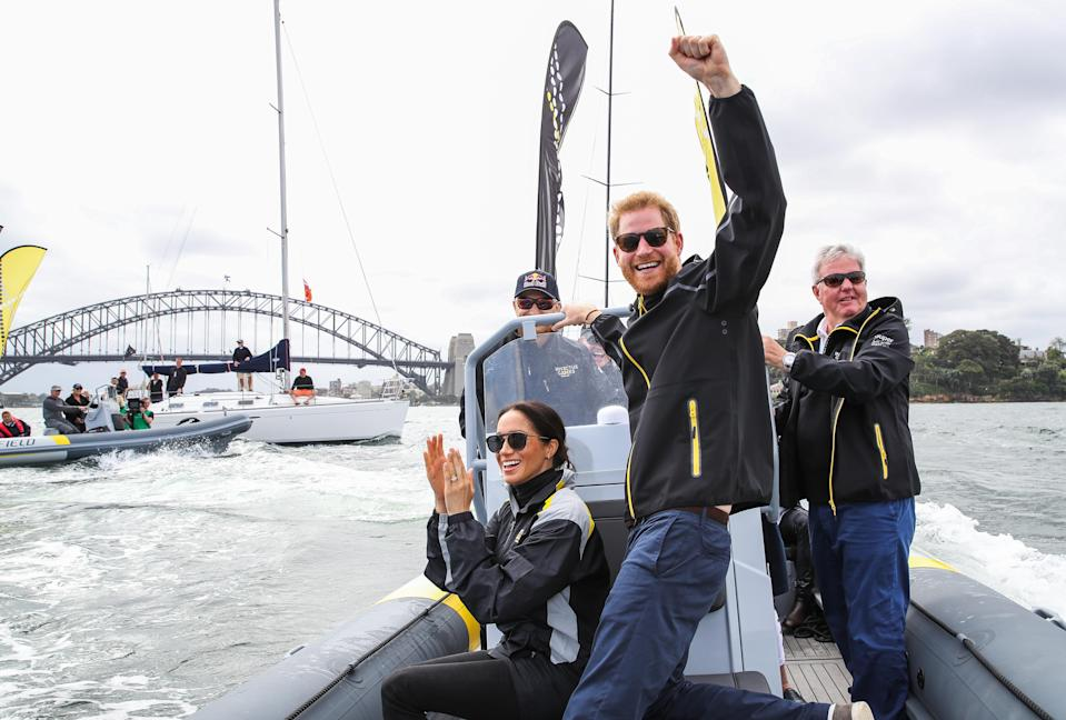 <p>Harry and Meghan watch the sailing trials during the Invictus Games in Australia (Getty) </p>
