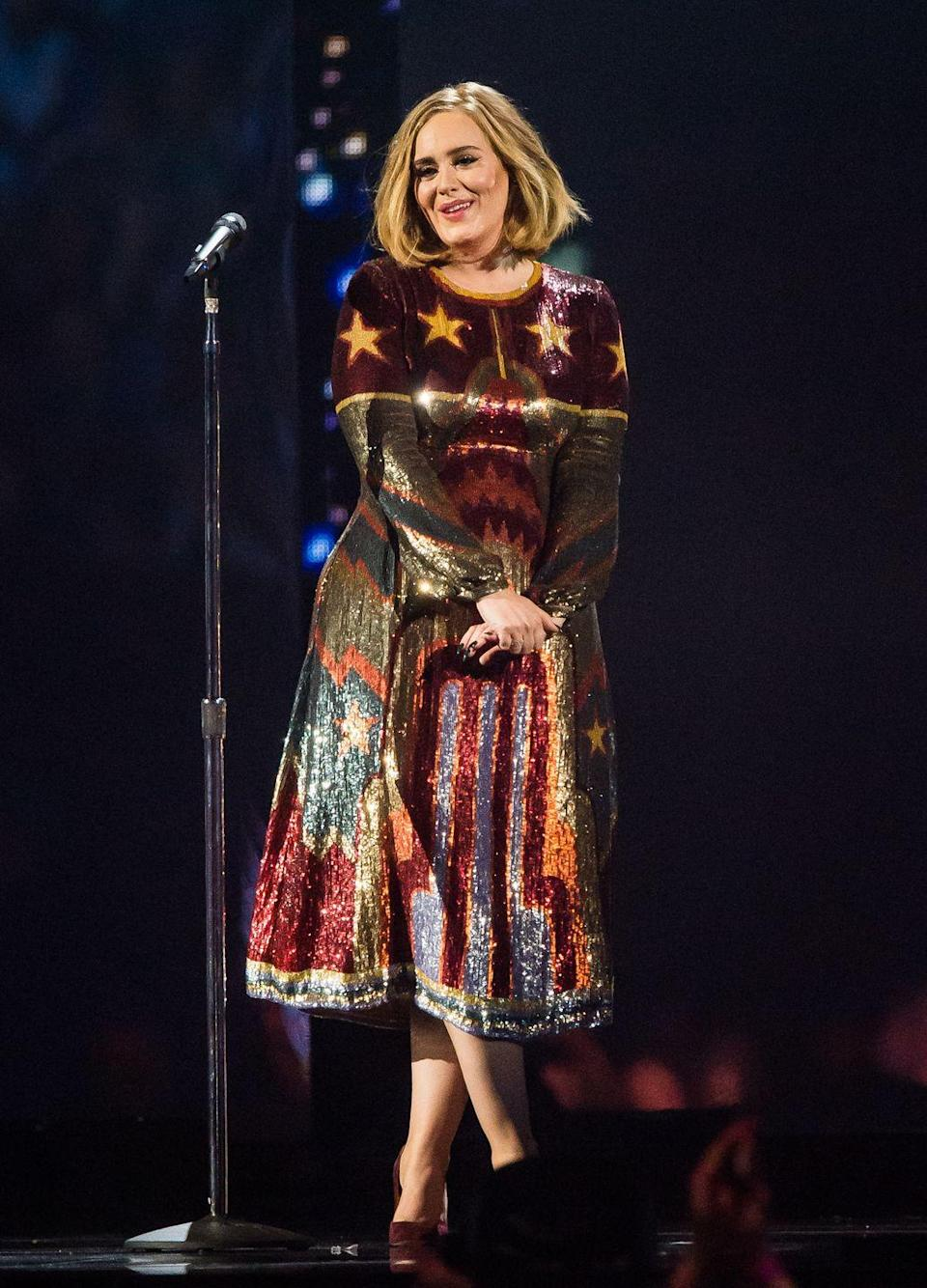 <p>Adele took to the stage during the 2016 Brit Awards to both perform and collect multiple awards, wearing this playful sequinned Valentino dress. </p>