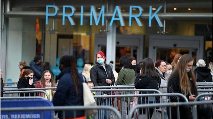 Shoppers queuing outside the Primark in Stoke-on-Trent