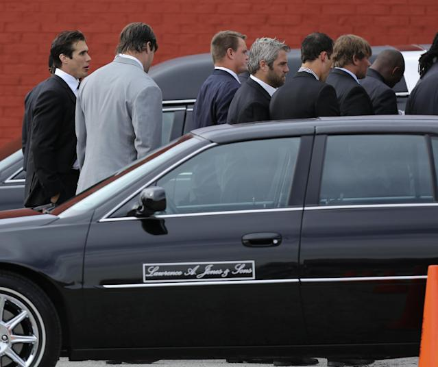 Kansas City Chiefs quarterback Brady Quinn, left, talks with a teammate as they arrive at a memorial service for Kansas City Chiefs' Jovan Belcher at the Landmark International Deliverance and Worship Center Wednesday, Dec. 5, 2012 in Kansas City, Mo. Belcher shot his girlfriend, Kasandra Perkins, at their home Saturday morning before driving to Arrowhead Stadium and turning the gun on himself. (AP Photo/Ed Zurga)