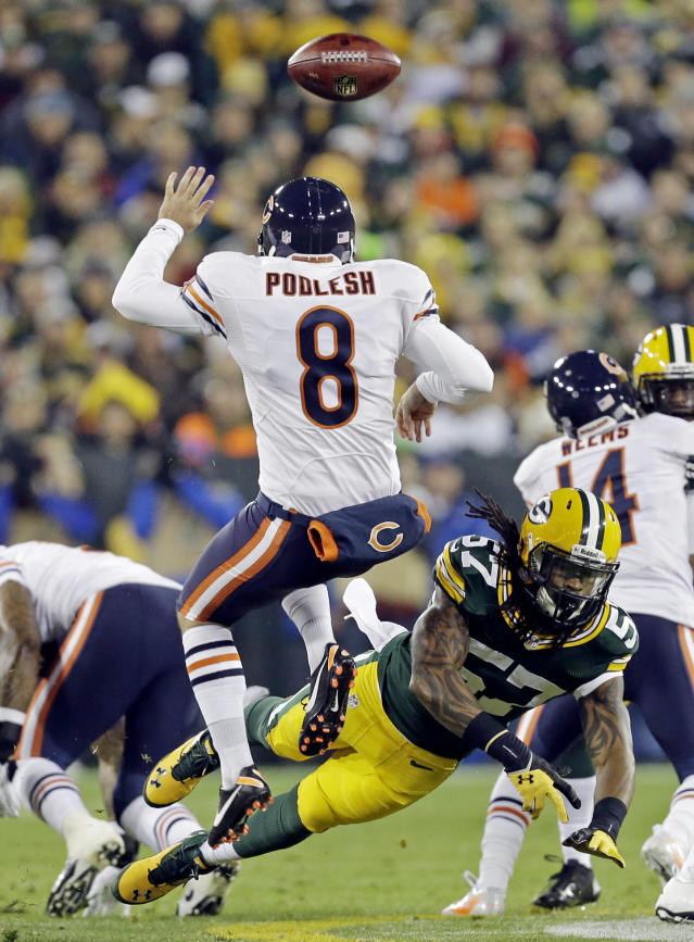 Green Bay Packers' Jamari Lattimore (57) blocks the punt of Chicago Bears' Adam Podlesh (8) during the first half of an NFL football game Monday, Nov. 4, 2013, in Green Bay, Wis. (AP Photo/Mike Roemer)