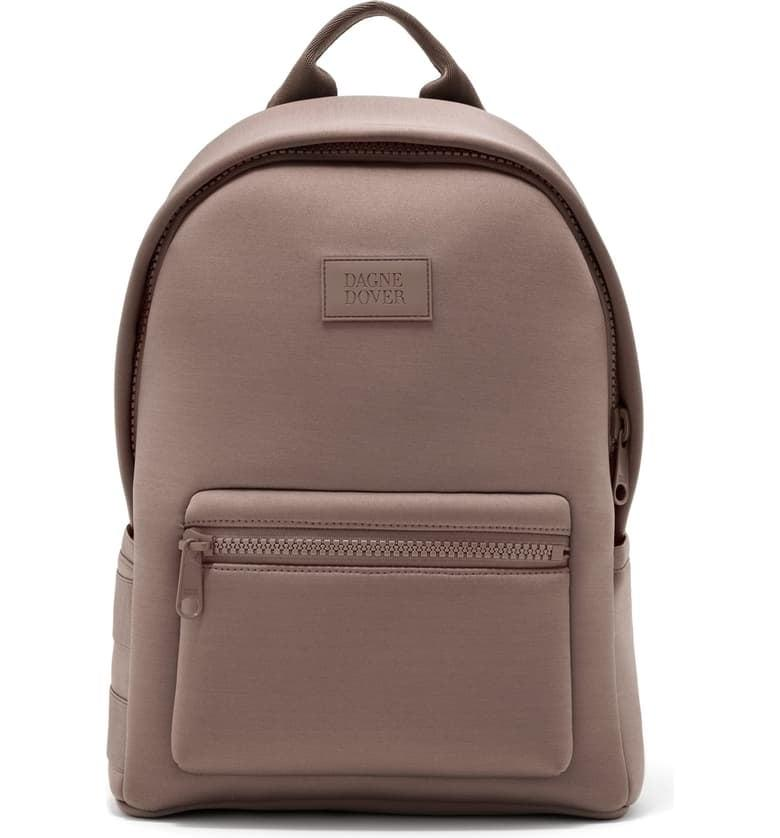 "<p>The dune-colored <a href=""https://www.popsugar.com/buy/Dagne-Dover-Medium-Dakota-Neoprene-Backpack-481012?p_name=Dagne%20Dover%20Medium%20Dakota%20Neoprene%20Backpack&retailer=shop.nordstrom.com&pid=481012&price=175&evar1=fit%3Aus&evar9=46507828&evar98=https%3A%2F%2Fwww.popsugar.com%2Ffitness%2Fphoto-gallery%2F46507828%2Fimage%2F46508345%2FDune-Dagne-Dover-Medium-Dakota-Neoprene-Backpack&list1=fitness%20gear%2Cbackpacks&prop13=mobile&pdata=1"" rel=""nofollow"" data-shoppable-link=""1"" target=""_blank"" class=""ga-track"" data-ga-category=""Related"" data-ga-label=""https://shop.nordstrom.com/s/dagne-dover-medium-dakota-neoprene-backpack/5327363?origin=coordinating-5327363-2375500-1-HP_CUST_HIS-recbot-recently_viewed_snowplow_mvp&amp;recs_placement=HP_CUST_HIS&amp;recs_strategy=recently_viewed_snowplow_mvp&amp;recs_source=recbot&amp;recs_page_type=home&amp;recs_seed=0"" data-ga-action=""In-Line Links"">Dagne Dover Medium Dakota Neoprene Backpack</a> ($175) is great for all seasons and is a good option for someone who gravitates toward neutral/earth tone colors. </p>"