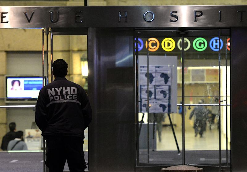 A police officer guards the entrance to New York's Bellevue Hospital on October 23, 2014 after a doctor who recently returned from West Africa was rushed in with Ebola symptoms