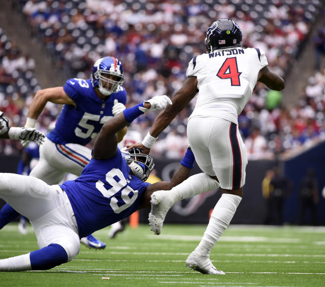 Houston Texans quarterback Deshaun Watson (4) is tackled by New York Giants defensive end Mario Edwards Jr. (99) during the second half of an NFL football game Sunday, Sept. 23, 2018, in Houston. (AP Photo/Eric Christian Smith)