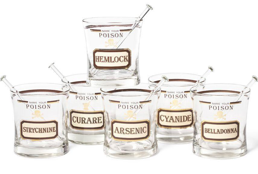 """<p>After World War II, an optimistic and increasingly suburban America embraced the at-home cocktail hour, leading to a glut of novelty barware that included toxin-themed glasses like these. Two companies, Georges Briard and Ceraglass, began making """"Name Your Poison"""" sets in the 1950s, issuing them in different shapes with varying graphics. Ceraglass likely manufactured this particular version in the late '60s. </p>"""
