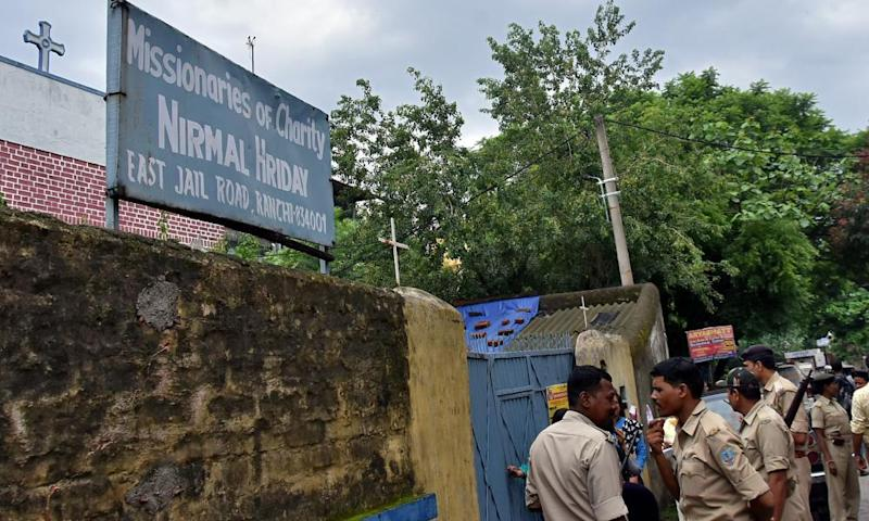 Police stand outside a home run by the Missionaries of Charity, in Ranchi, India.