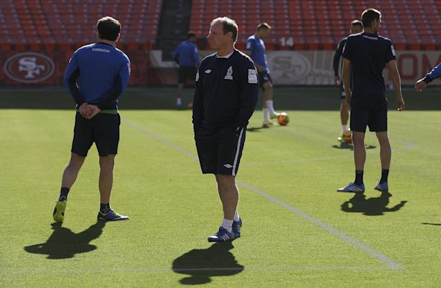 Azerbaijan soccer head coach Berti Vogts, center, watches as his team begins practice at Candlestick Park in San Francisco, Sunday, May 25, 2014. (AP Photo/Jeff Chiu)