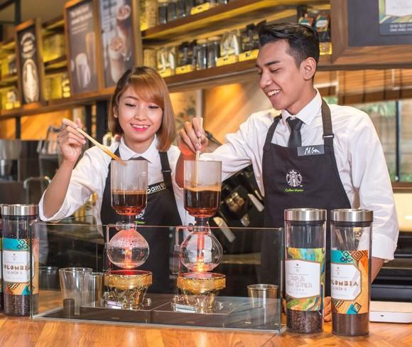 Two Starbucks employees in a Southeast Asia store.