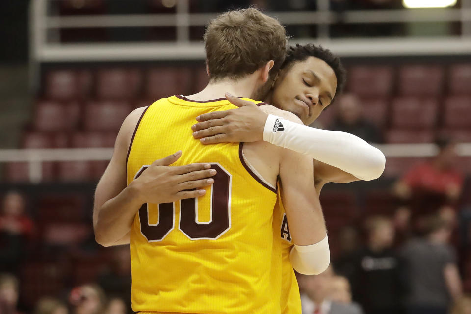 Arizona State forward Mickey Mitchell (00) celebrates with guard Alonzo Verge Jr. during the second half of the team's NCAA college basketball game against Stanford in Stanford, Calif., Thursday, Feb. 13, 2020. (AP Photo/Jeff Chiu)