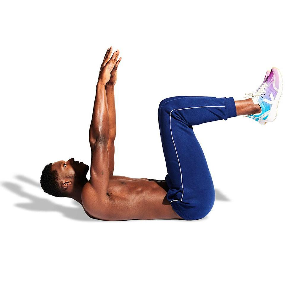 <p>Lie on the floor and raise your arms. Bring your legs up, pulling your knees towards you. Point your kneecaps at the ceiling, with your calves parallel to the ground. Keep your toes pointing up, too.</p>