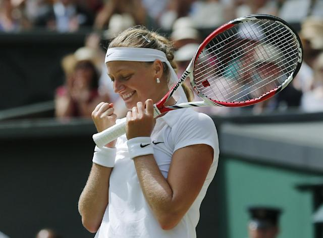 Petra Kvitova of Czech Republic celebrates after defeating Lucie Safarova of Czech Republic in their women's singles semifinal match at the All England Lawn Tennis Championships in Wimbledon, London, Thursday, July 3, 2014. (AP Photo/Ben Curtis)