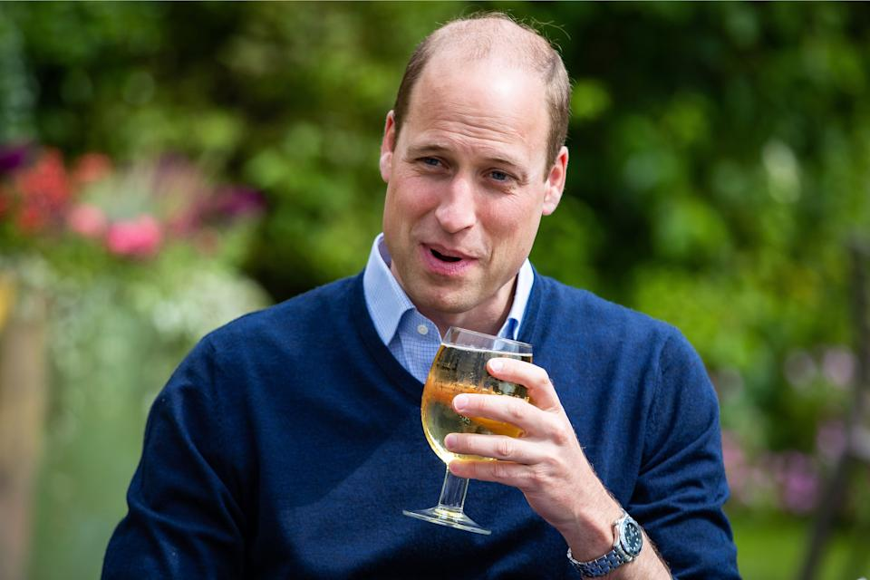 Britain's Prince William, Duke of Cambridge, gestures as he takes a sip of an Aspalls cider at The Rose and Crown pub in Snettisham in eastern England on July 3, 2020, as English pubs and restaurants prepare to reopen after their enforced closure due to the coronavirus pandemic.