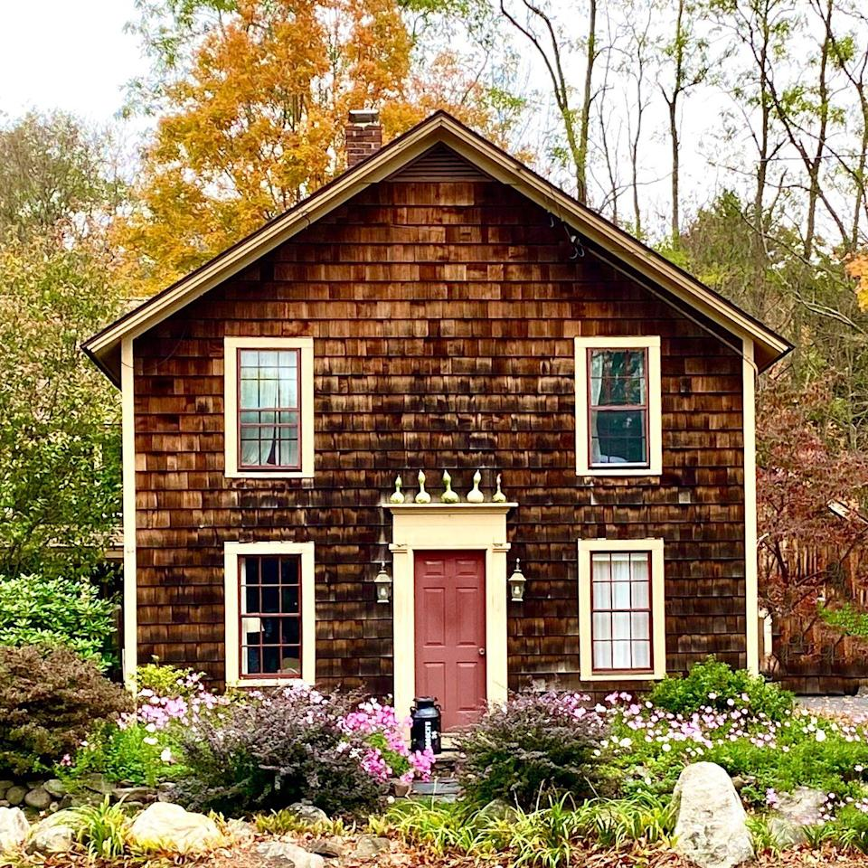 <p>Brown cedar shingles pair nicely with a vintage red paint. Also try pale blue or green for a fresh update on this old school exterior. </p>