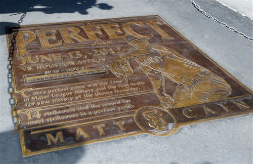 A plaque honors San Francisco Giants pitcher Matt Cain for his perfect game in June, after it was unveiled before the Giants' baseball game against the Colorado Rockies in San Francisco, Friday, Aug. 10, 2012. (AP Photo/Tony Avelar)
