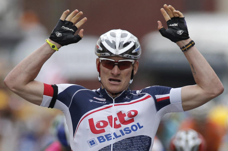 Andre Greipel of Germany crosses the finish line to win the fifth stage of the Tour de France cycling race over 196.5 kilometers (122 miles) with start in Rouen and finish in Saint-Quentin, France, Thursday July 5, 2012. (AP Photo/Laurent Rebours)