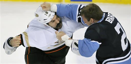 Anaheim Ducks' George Parros (16) fights with Florida Panthers' Krystofer Barch (21) during the first period of an NHL hockey game on Sunday, Feb. 19, 2012, in Sunrise, Fla. (AP Photo/Gary I Rothstein)