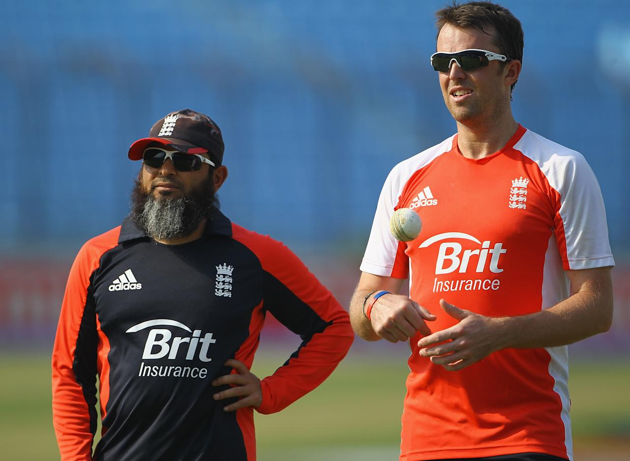 CHITTAGONG, BANGLADESH - MARCH 10:  Mushtaq Ahmed, bowling coach of England and Graeme Swann of England in action during an England Training Session at the Zahur Ahmed Chowdhury Stadium on March 10, 2011 in Chittagong, Bangladesh.  (Photo by Matthew Lewis/Getty Images)