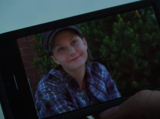 hand holding a smartphone displaying a photo of adam torres on degrassi