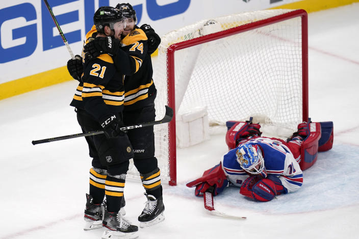 Boston Bruins left wing Nick Ritchie (21) is congratulated by Jake DeBrusk after his goal against New York Rangers goaltender Keith Kinkaid during the second period of an NHL hockey game, Saturday, May 8, 2021, in Boston. (AP Photo/Charles Krupa)
