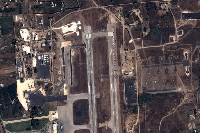 This handout image taken by EADS' Astrium Press on September 20, 2015 by Pleiades Satellite shows a view of Russian fighter jets and helicopters at a military base in the government-controlled coastal Syrian city of Latakia (AFP Photo/)