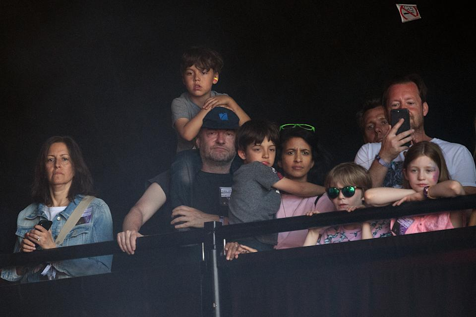 GLASTONBURY, ENGLAND - JUNE 30: Writer Charlie Brooker (2L) and his wife Konnie Huq (C) watch Miley Cyrus perform on the Pyramid Stage on day five of Glastonbury Festival at Worthy Farm, Pilton on June 30, 2019 in Glastonbury, England. Glastonbury is the largest greenfield festival in the world, and is attended by around 175,000 people.  (Photo by Leon Neal/Getty Images)