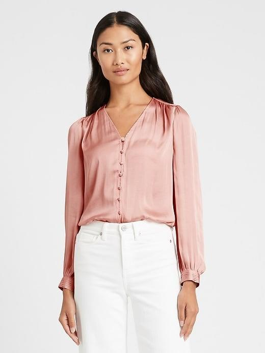 <p>Stand out in your next virtual meeting with a petal-pink <span>Banana Republic Soft Satin V-Neck Blouse</span> ($23, originally $85). </p>