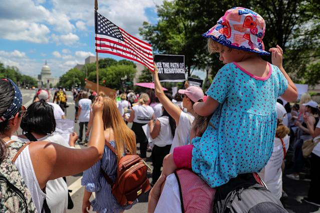 "<p>A child raises her hand in protest as she and her mother join demonstrators to rally and march calling for ""an end to family detention"" and in opposition to the immigration policies of the Trump administration in Washington, D.C., June 28, 2018. (Photo: Jonathan Ernst/Reuters) </p>"