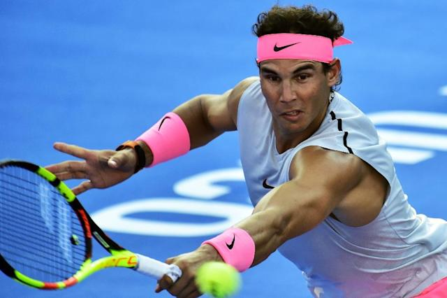 Spain's Rafael Nadal hits a return during an exibition match in Acapulco on February 25, 2018, on the eve of the start of the ATP Mexican Open (AFP Photo/PEDRO PARDO)