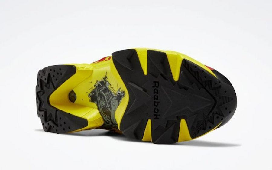 The bottom of a sneaker, featuring yellow and black with the image of a car's undercarriage in the middle