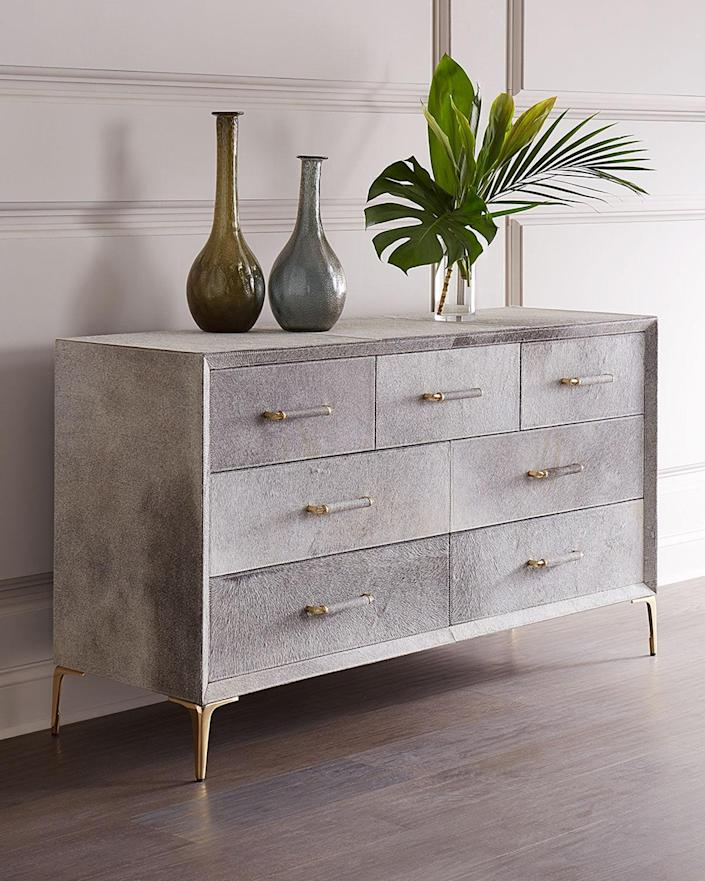 """Weighing a whopping 206 pounds, this cool dresser will definitely be the star of a space. It may be heavy, but it's still a piece you may not want to spill anything on. After all, getting a stain out of gray-dyed cowhide comes with its own set of challenges. $8449, Horchow. <a href=""""https://www.horchow.com/Interlude-Home-Jaxon-Hairhide-Grand-Chest-Dressers-Armoires/cprod151980046_cat23930747__/p.prod?"""" rel=""""nofollow noopener"""" target=""""_blank"""" data-ylk=""""slk:Get it now!"""" class=""""link rapid-noclick-resp"""">Get it now!</a>"""